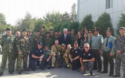 Tajik firefighters and officers with members of the UK team and Ambassador Philpott