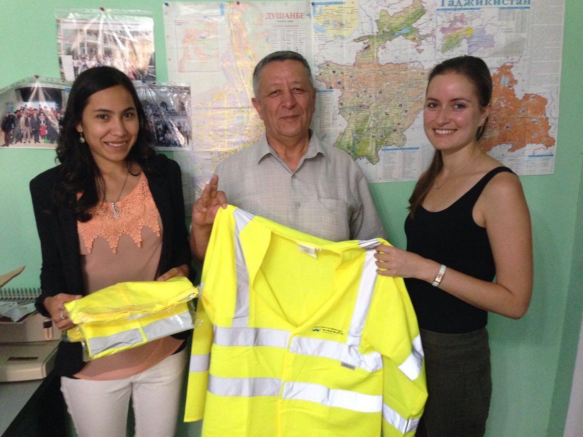 Kumush Murtazokulova receives the Kier-donated high vis clothing from EASST and FIRE AID's Julie Utting which will be used in Young Generation of Tajikistan's road safety campaigns